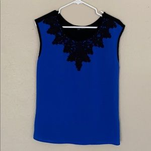 Black and blue sleeveless blouse